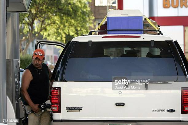 Man fills up his tank at the beginning of the 4th of July holiday weekend on June 30, 2006 in San Francisco, California. Despite the rising cost of...