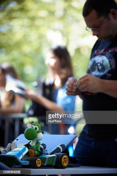 A man finalizes his robot car A robots race took place in Toulouse Machines are either cars or walking robots They were supposed to run a 110 meters...