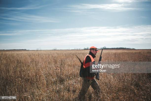 Man Finishing Up His Pheasant Hunt