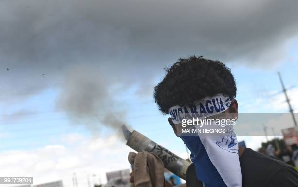 TOPSHOT A man fires a homemade mortar during a protest against Nicaraguan President Daniel Ortega's government in Managua on July 4 2018 Thousands of...