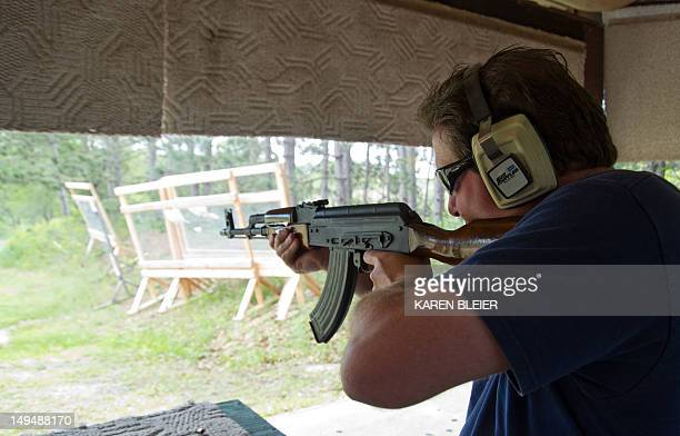 A man fires an AK47 semiautomatic rifle June 3 2012 at the St Croix Rod and Gun Club in Hudson Wisconsin AFP PHOTO/Karen BLEIER