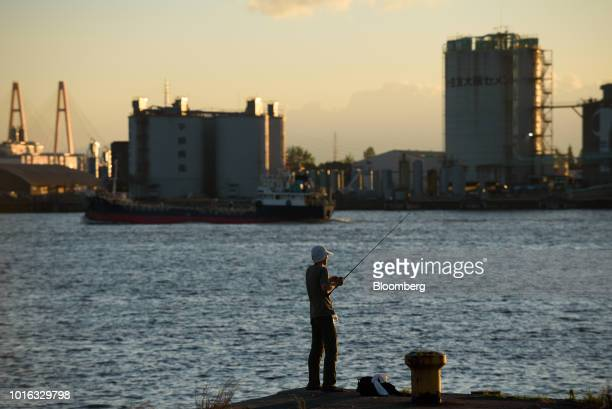 A man fishes at a port in Nagoya Japan on Tuesday July 31 2018 Japan is scheduled to release trade balance figures for July on Aug 16 Photographer...