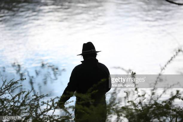 Man fishes at the Stony Point Battlefield historical landmark and state park which is seen quite during Covid-19 pandemic in New York, United States...