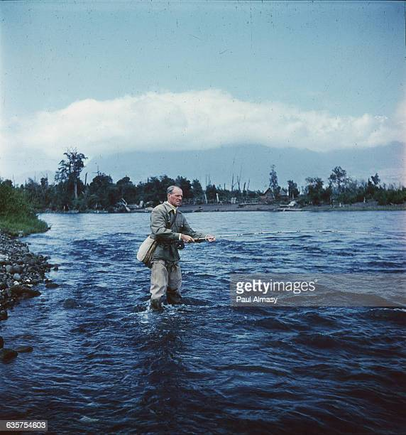 A man fishes for salmon in the Rio Minetue near Pucon in Chile | Location Rio Minetue near Pucon Chile