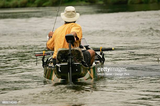 Man Fishes For Smallmouth Bass On River