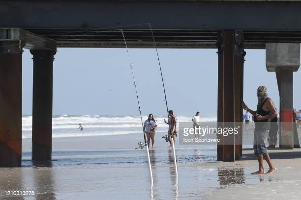A man fishes from the shore during the beaches first open hour on April 17 2020 in Jacksonville Beach Fl Jacksonville Mayor Lenny Curry opened the...