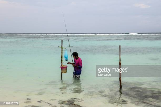 A man fishes in the sea off Hulhumale an artificial island built up to 3 metres above sea level next to the capital city of Male in anticipation of...