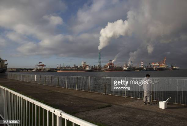 A man fishes near the Nippon Steel Sumitomo Metal Corp plant in Kamisu Ibaraki Japan on Wednesday April 18 2018 President Donald Trump and Japanese...