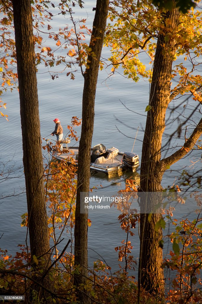 A man fishes on a crisp autumn day at Lake of the Ozarks