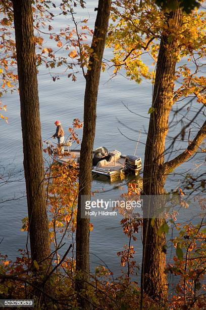 A man fishes on a crisp autumn day at Lake of the Ozarks Missouri