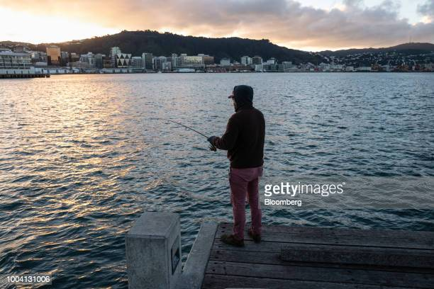 Buildings stand illuminated at dawn in Wellington New Zealand on Wednesday July 18 2018 New Zealandinflationpicked up in the second quarter amid...