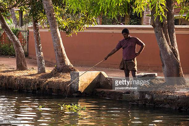 Man fishing along the Kerala Backwaters in India