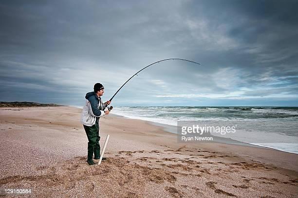 Man fishing at beach