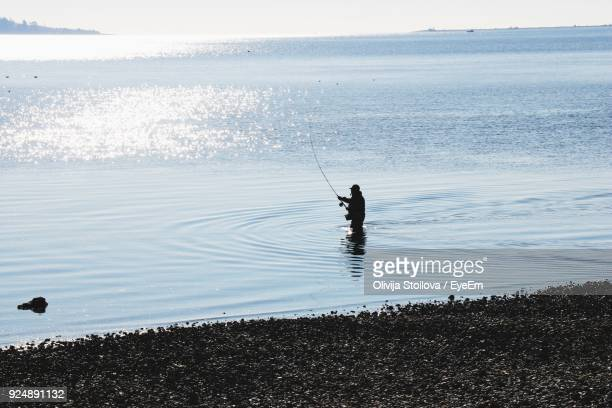 man fishing at beach - victoria canada stock pictures, royalty-free photos & images