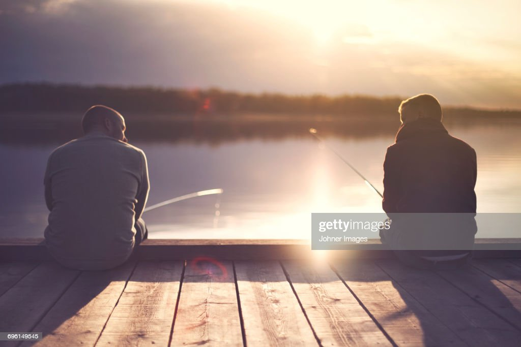 Man fishing at lake : Stock Photo