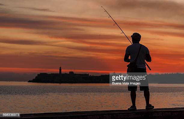 Man fishing at sunrise
