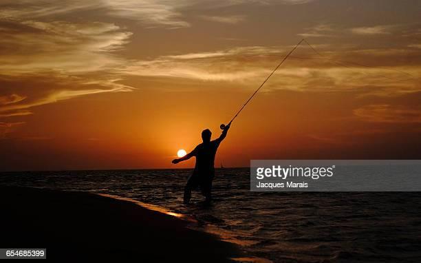 Man fishing at sunset near Inhaca Island, Maputo, Mozambique, Africa