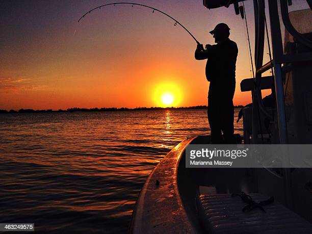 man fishing at sunset - costa del golfo degli stati uniti d'america foto e immagini stock