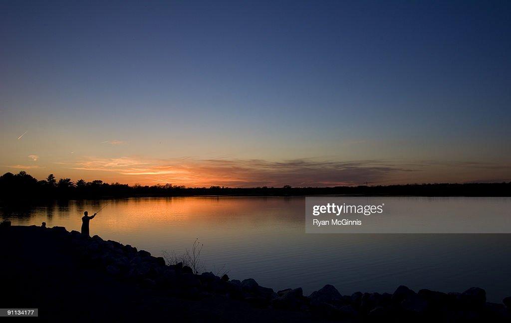 Man Fishing at Sunset : Stock Photo