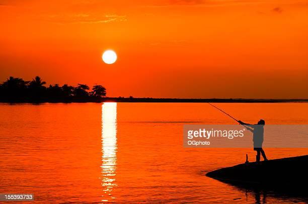 Man fishing during sunset