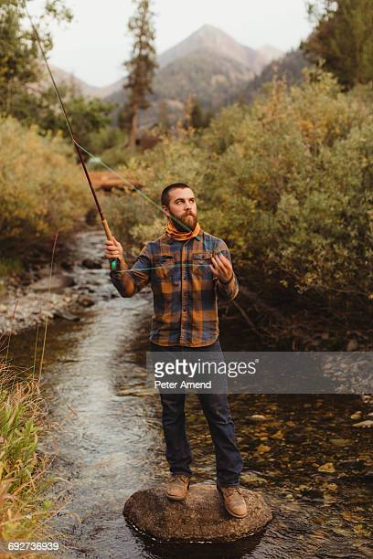 Man fishing in creek, Mineral King, Sequoia National Park, California, USA
