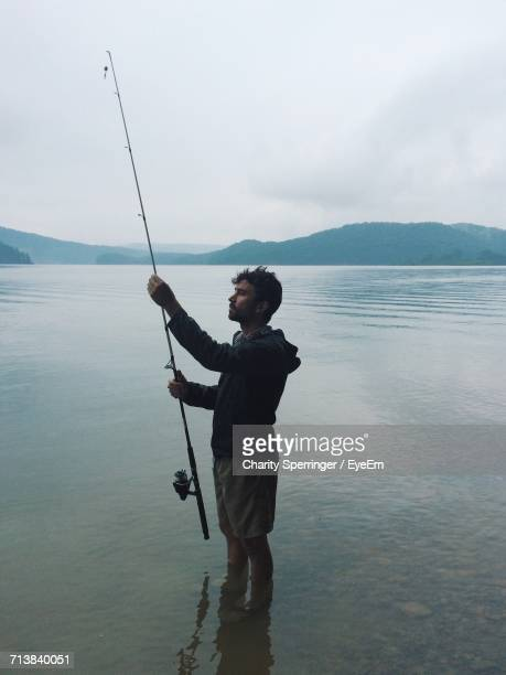 Man Fishing In Shallow Water
