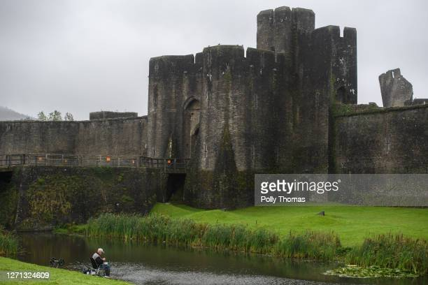 A man fishing in the Caerphilly Castle moat on September 08 2020 in Caerphilly United Kingdom The county borough of Caerphilly in South Wales is to...