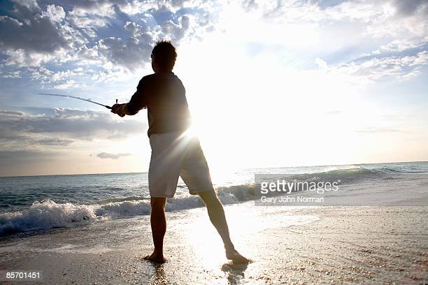 man fishing off beach - juno beach florida stock pictures, royalty-free photos & images