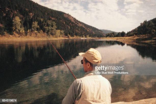 Man Fishing on Clear Lake