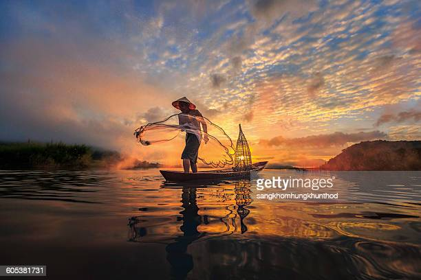 Man fishing on Mekong River, Nong Khai Province, Thailand
