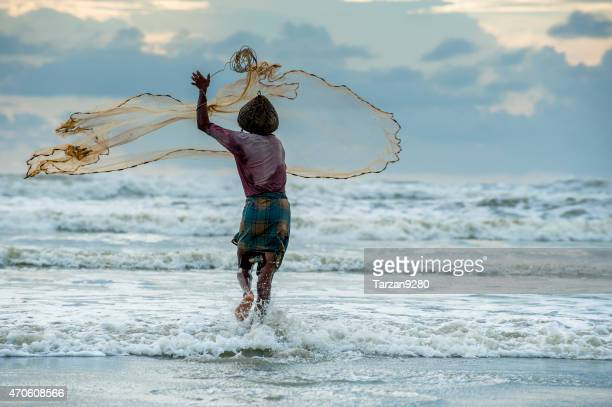 man fishing on the beach, bangladesh - fishing in bangladesh stock photos and pictures