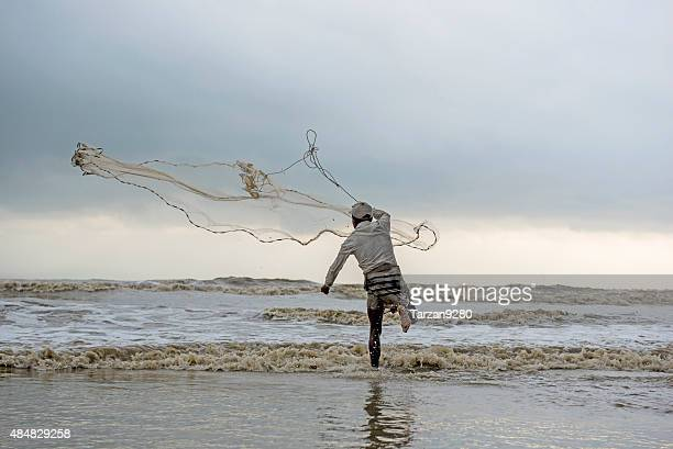 man fishing on the beach of cox's bazar, bangladesh - cox bazar sea beach stock pictures, royalty-free photos & images