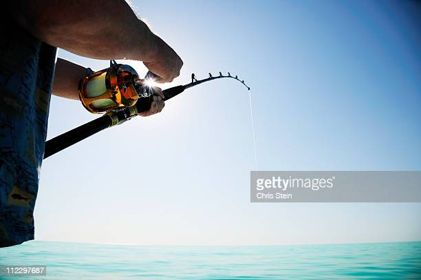 man fishing on the open water - fishing stock pictures, royalty-free photos & images