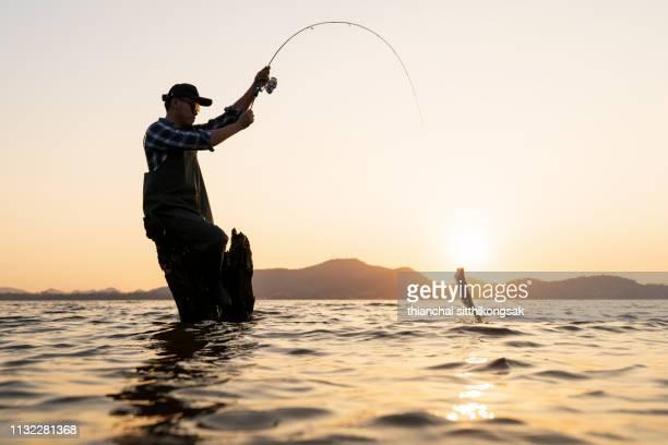 man fishing - angeln stock-fotos und bilder
