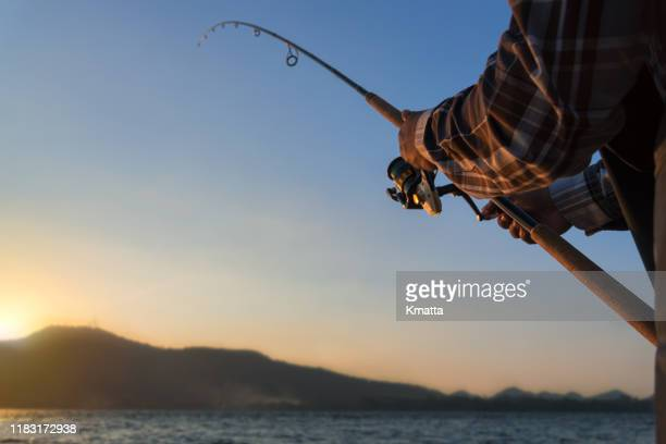man fishing - bass fishing stock pictures, royalty-free photos & images