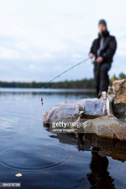 man fishing - dalsland stock photos and pictures