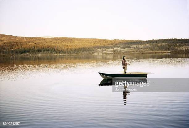 man fishing - commercial_fishing stock pictures, royalty-free photos & images