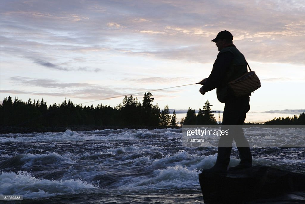 A man fishing Sweden. : Stock Photo