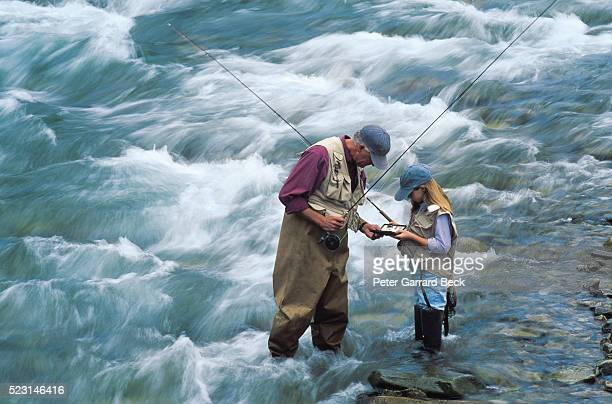Man Fishing with Granddaughter in East River, CO