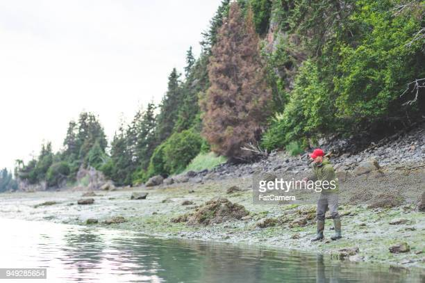 man fishing with rod and reel in alaska - kachemak bay stock pictures, royalty-free photos & images