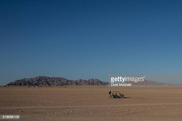 A man fixes a quad runner during a desert tour on April 2 2016 in Sharm El Sheikh Egypt Prior to the Arab Spring in 2011 some 15million tourists...