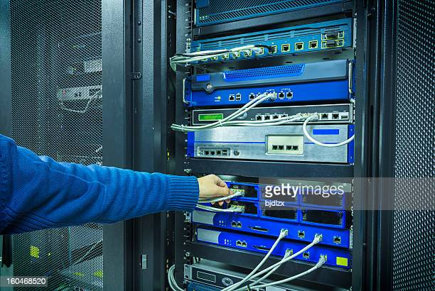 A man fixing a network patchwork