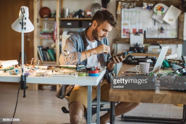 Man fixing electronic circuit