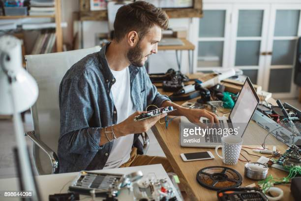 man fixing electronic circuit - electronics stock pictures, royalty-free photos & images