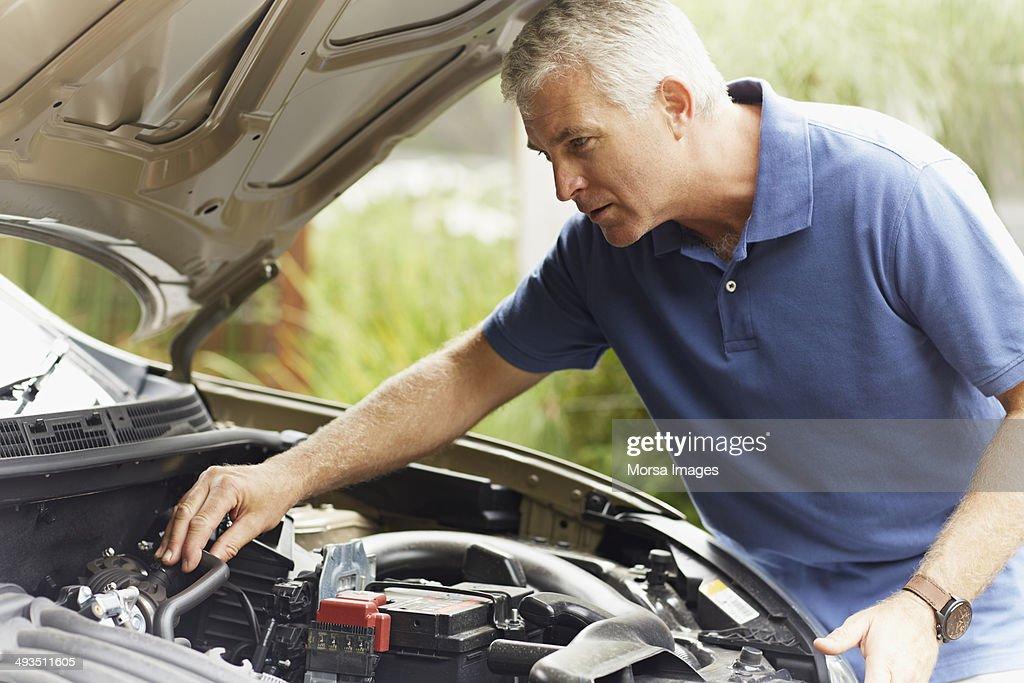 Man fixing his car engine : Stock Photo