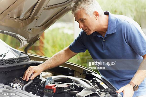 Man fixing his car engine