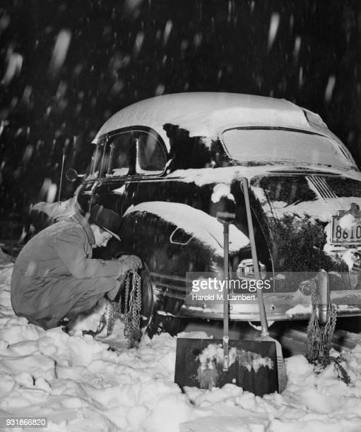 Man fixing his car in winter