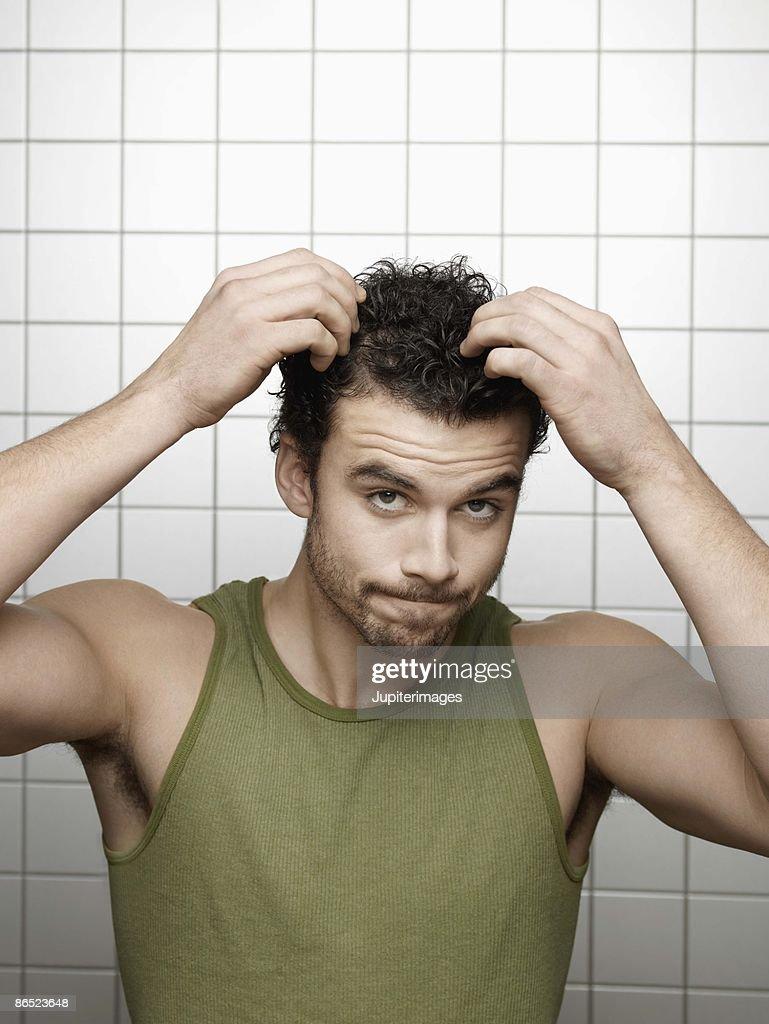 Man fixing his hair : Stock Photo