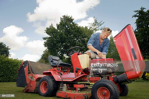 Man fixing lawn mower