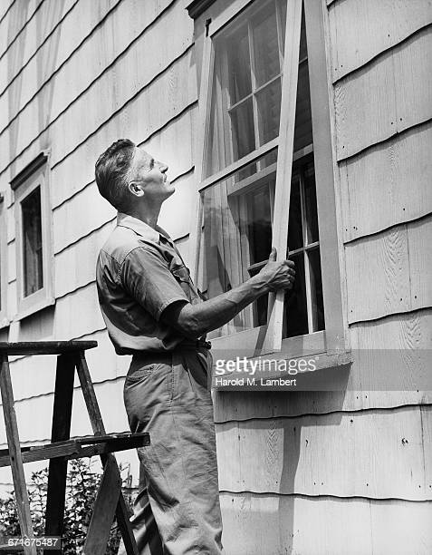 man fixing window glass  - number of people stock pictures, royalty-free photos & images